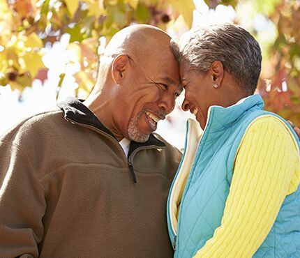 Older couple laughing and smiling and enjoying life together